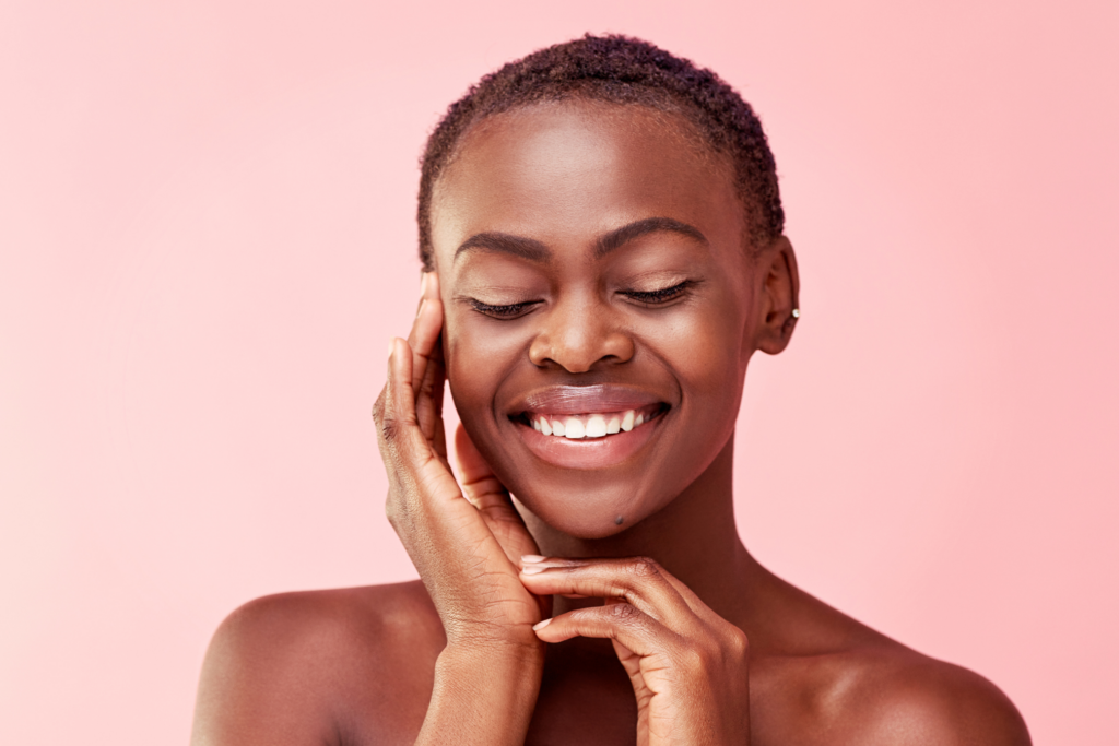 Woman glowing after microneedling treatment